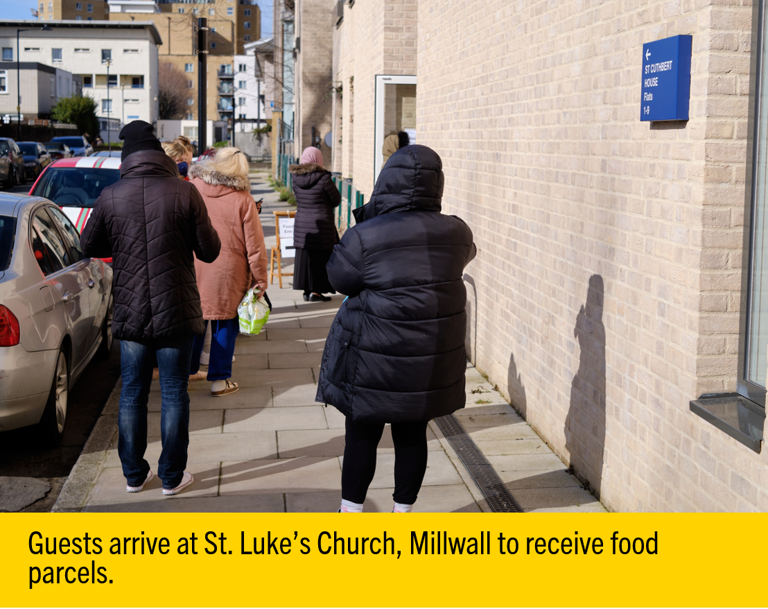 Guests at a food bank hosted by St. Luke's Church in Millwall